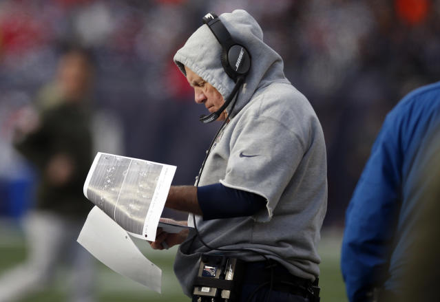 "Patriots head coach Bill Belichick reviews photographs on the sideline during the first half of last Sunday's game against the <a class=""link rapid-noclick-resp"" href=""/nfl/teams/mia/"" data-ylk=""slk:Miami Dolphins"">Miami Dolphins</a>. (AP)"