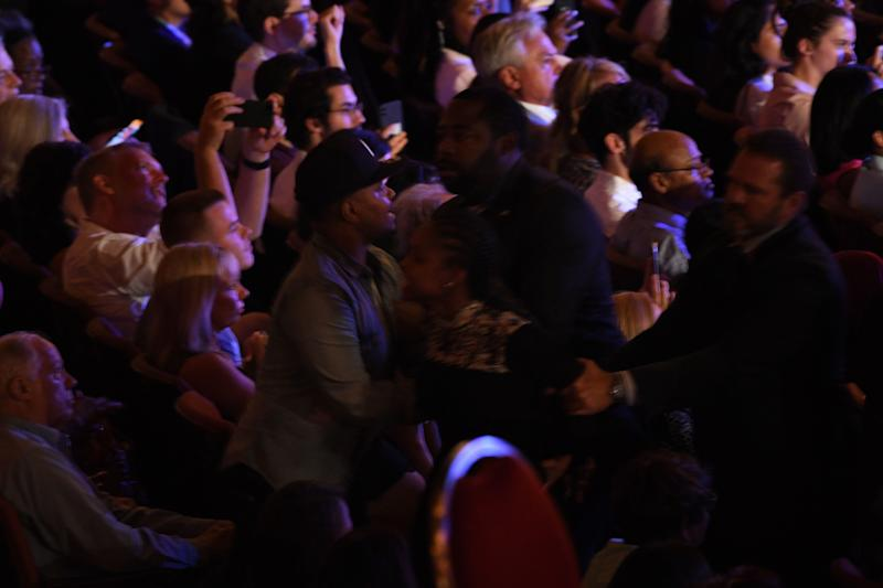 Protesters are removed as Democratic presidential hopefuls deliver opening remarks during the second round of the second Democratic primary debate of the 2020 presidential campaign season hosted by CNN at the Fox Theatre in Detroit, Michigan on July 31, 2019. - Protesters changed