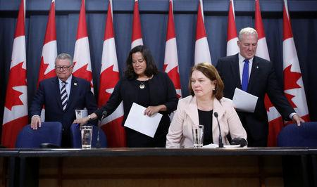 Canada's Public Safety Minister Ralph Goodale, Justice Minister Jody Wilson-Raybould, Health Minister Jane Philpott and Bill Blair arrive at a news conference in Ottawa