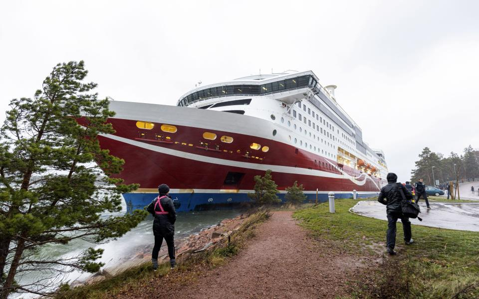"""A view of the Viking Line cruise ship Viking Grace, run aground with passengers on board, south of Mariehamn, Finland, Saturday, Nov. 21, 2020. A Baltic Sea ferry with 331 passengers and a crew of 98 has run aground in the Aland Islands archipelago between Finland and Sweden. Finnish authorities say there are """"no lives in immediate danger"""" and the vessel isn't leaking. The Finnish coast guard tweeted Saturday afternoon that the Viking Line ferry that runs between the Finnish port city of Turku and Swedish capital Stockholm hit ground just off the port of Mariehamn, the capital of the Aland Islands. (Niclas Nordlund/Lehtikuva via AP)"""
