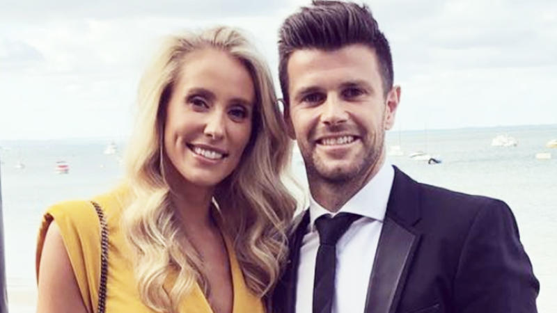 Brooke Cotchin and her husband Trent Cotchin pose for a photo.