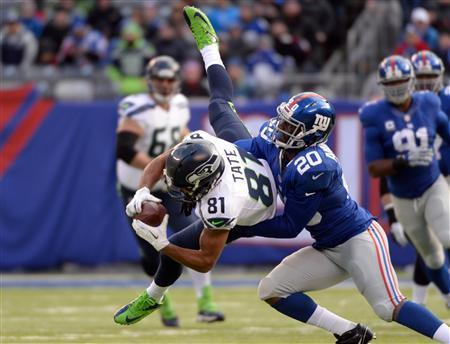 East Rutherford, NJ, USA; Seattle Seahawks wide receiver Golden Tate (81) is tackled by New York Giants cornerback Prince Amukamara (20) in the first half during the game at MetLife Stadium. Robert Deutsch-USA TODAY Sports
