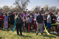 Spectators not named Josh record the battle from the safety of the sidelines as the Joshs battled in an open green space in Air Park on Saturday, April 24, 2021, in Lincoln, Neb. What started as a mid-pandemic joke took on life Saturday, as a mixed bag of individuals sharing only their name came to battle it out. The winner was to be declared the rightful owner of the name. (Kenneth Ferriera/Lincoln Journal Star via AP)