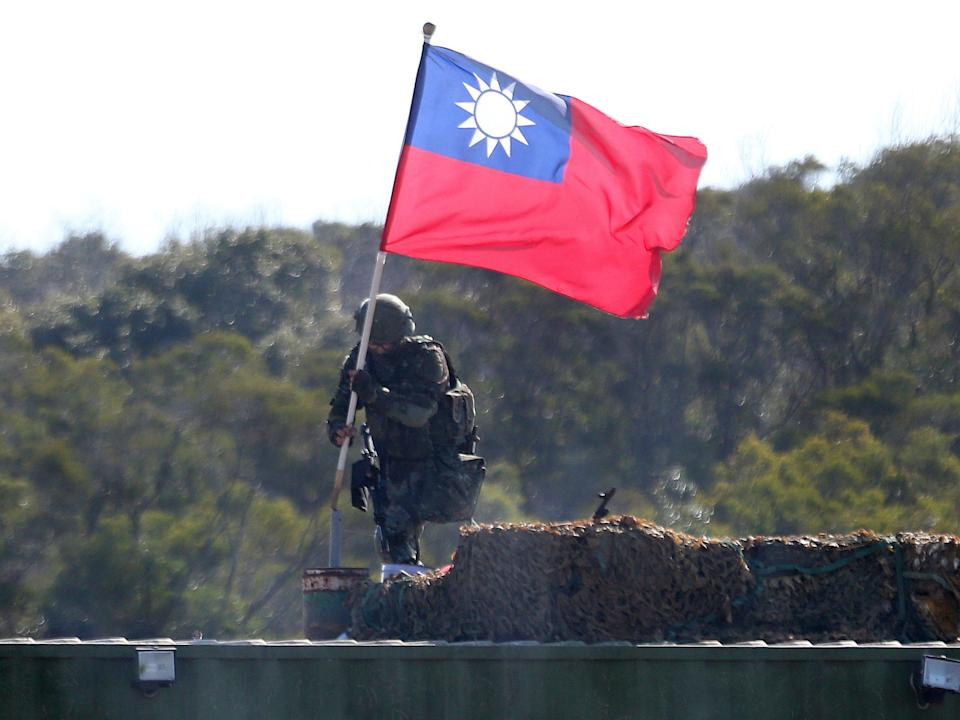 A soldier holds a Taiwanese flag during a military exercise aimed at repelling an attack from China (AP)