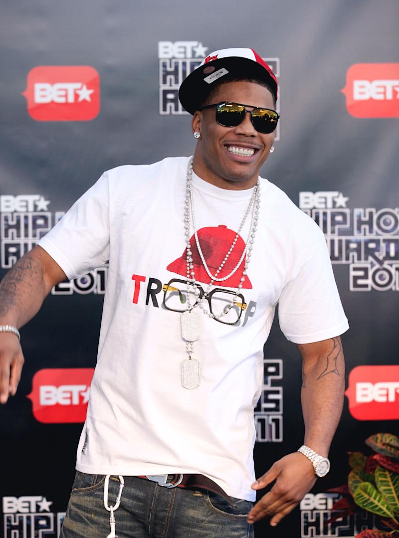 FILE - This Oct. 1, 2011 file photo shows rapper Nelly arriving for the BET Hip Hop Awards in Atlanta. Authorities say they found drugs and a gun on rapper Nelly's tour bus at a West Texas border checkpoint where several celebrities have been arrested. Hudspeth County sheriff's officials said an initial search Wednesday, Oct. 10, 2012, turned up small amounts of marijuana and heroin and a loaded gun. Authorities say a second search revealed a duffel bag with about 10 pounds of pot. (AP Photo/David Goldman, file)