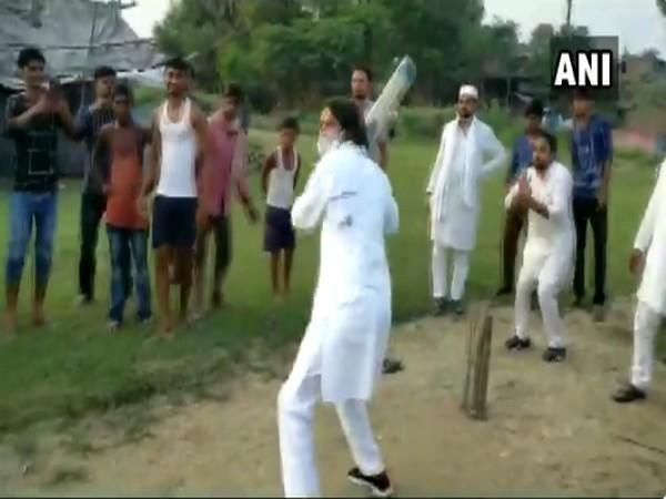 RJD leader Tej Pratap Yadav playing cricket with children in Hasanpur constituency on Sunday.