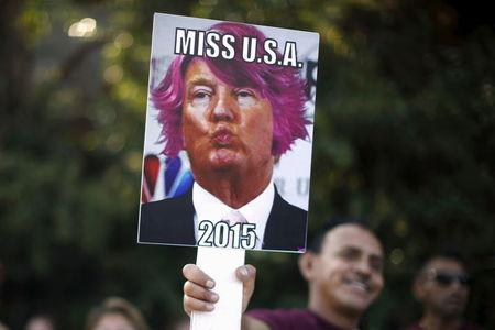 People protest outside the Luxe Hotel, where Republican presidential candidate Donald Trump was expected to speak in Brentwood, Los Angeles, California, United States July 10, 2015.  REUTERS/Lucy Nicholson