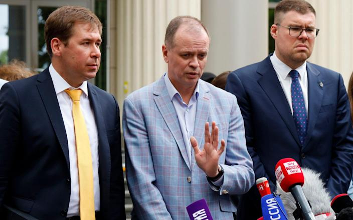 The FBK's legal team outside the court in Moscow on Wednesday - AP