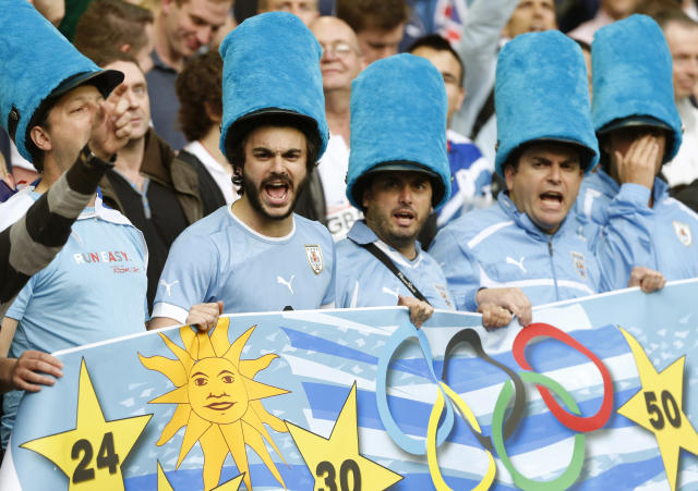 Uruguay fans in costume sing before the Britain - Uruguay match in men's Group A football at the London 2012 Olympic Games at Millennium Stadium in Cardiff August 1, 2012. REUTERS/Francois Lenoir (BRITAIN - Tags: SPORT SOCCER SPORT OLYMPICS)