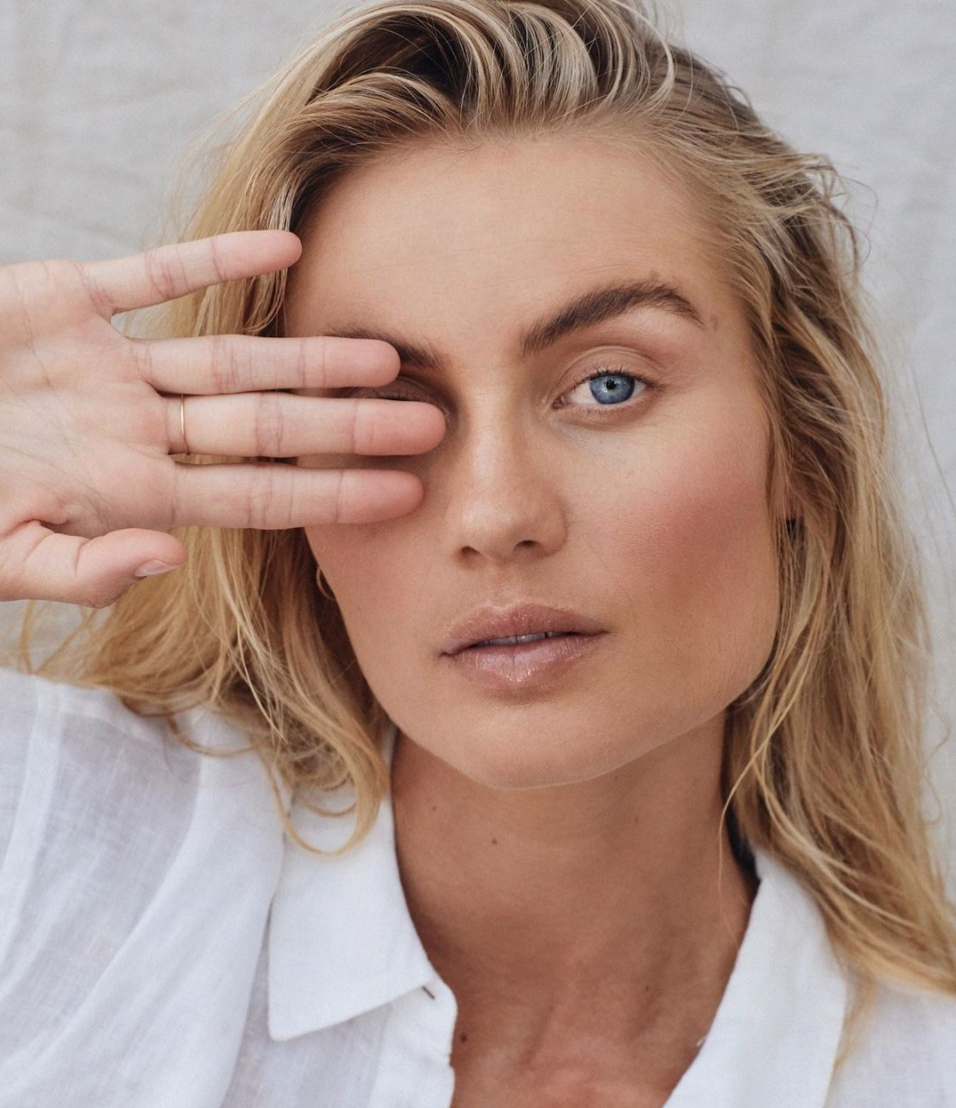 Close up of Australian model Elyse Knowles posing with one hand over her eye for beauty brand Maaemo Organics