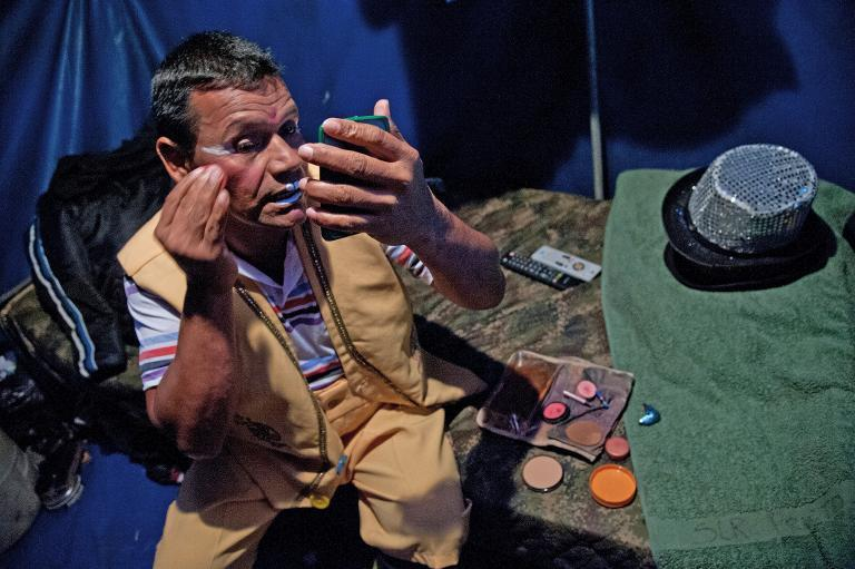 Clown Cascabelin (Soldier Daniel Borja) does his make-up before performance in the show of the Army's Colombia Circus in Tibirita, Cundinamarca department, on March 8, 2014