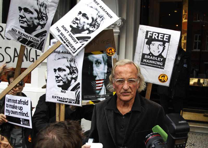 John Pilger, an Australian journalist, broadcaster and documentary maker, talks to members of the media after meeting WikiLeaks founder Julian Assange, at the Ecuadorian Embassy, in London, Friday, June 22, 2012. Assange entered the embassy on Monday in an attempt to gain political asylum to prevent him from being extradited to Sweden to face allegations of sex crimes, which he denies. In a telephone interview with the Australian Broadcasting Corporation (ABC) from inside the embassy, the 40-year-old Australian said he did not know when the decision would be made. (AP Photo/Lefteris Pitarakis)