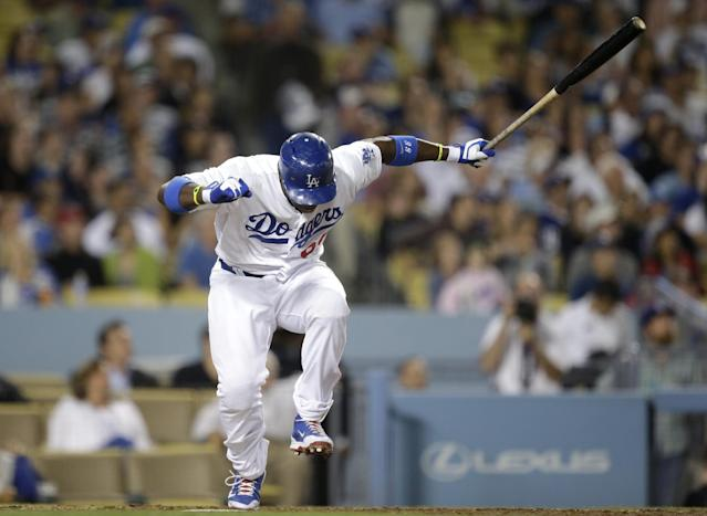 Los Angeles Dodgers' Yasiel Puig reacts after hitting a fly ball during the fifth inning of a baseball game against the San Francisco Giants on Friday, Sept. 13, 2013, in Los Angeles. (AP Photo/Jae C. Hong)