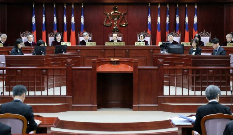 A panel of 14 grand justices will make the ruling in a case that centres on whether Taiwan's current law is unconstitutional.