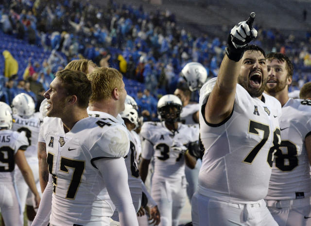 Central Florida defensive back Jonathan Gebka (L) and offensive lineman Wyatt Miller (R) celebrate after the team's win against Memphis on Saturday, Oct. 13, 2018, in Memphis, Tenn. (AP Photo/Mark Zaleski)
