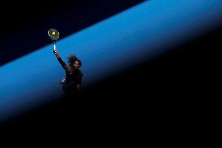 Serena Williams of the U.S. serves during her women's singles third round tennis match against Nicole Gibbs of the U.S. in the Australian Open 2017 in Melbourne, Australia January 21, 2017. REUTERS/Jason Reed/Files