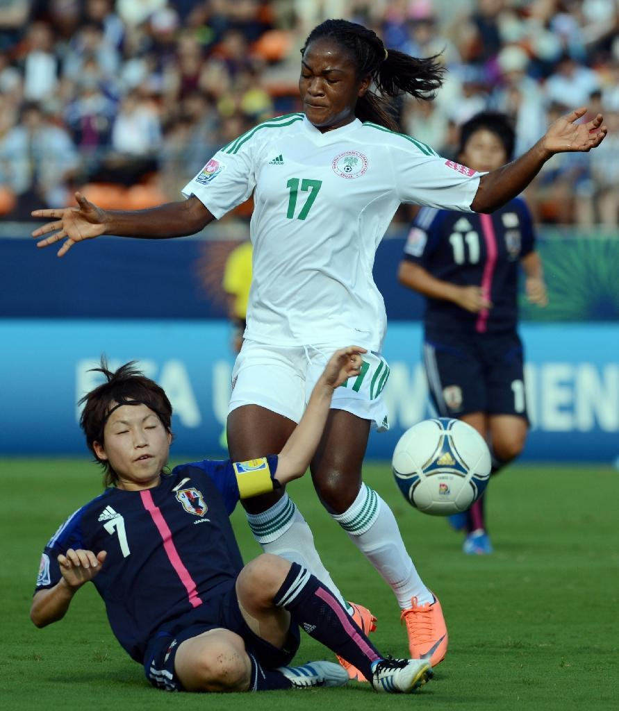 After going to every World Cup since 1991, Nigeria hope to finally bring the trophy home with a blend of young talent like Asisat Oshoala, Desire Oparanozie, and Francisca Ordega, pictured, alongside experienced campaigners (AFP Photo/Toshifumi Kitamura)