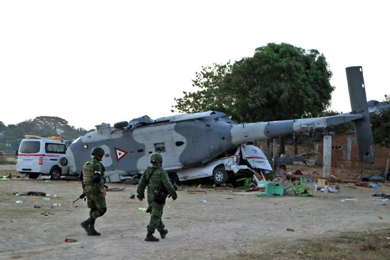 Thirteen people, all on the ground, were killed when a military helicopter carrying Mexico's interior minister crashed near the epicenter of a 7.2 magnitude quake that shook parts of the country