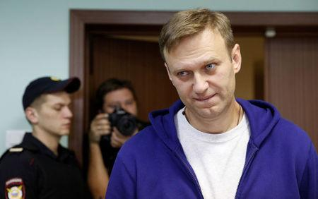Russian opposition leader Alexei Navalny attends an appeal against his jail for repeatedly violating laws governing the organisation of public meetings and rallies, at Moscow city court in Moscow