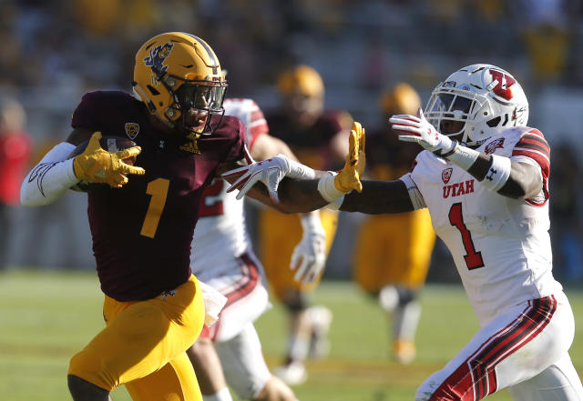 "Arizona State wide receiver N'Keal Harry (1) fends off Utah defensive back <a class=""link rapid-noclick-resp"" href=""/ncaaf/players/277242/"" data-ylk=""slk:Jaylon Johnson"">Jaylon Johnson</a> in the second half of an NCAA college football game, Saturday, Nov. 3, 2018, in Tempe, Ariz. (AP Photo/Rick Scuteri)"