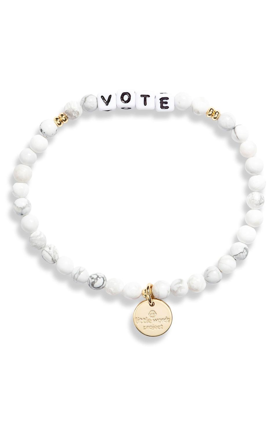 """<p><strong>LITTLE WORDS PROJECT</strong></p><p>nordstrom.com</p><p><strong>$20.00</strong></p><p><a href=""""https://go.redirectingat.com?id=74968X1596630&url=https%3A%2F%2Fwww.nordstrom.com%2Fs%2Flittle-words-project-vote-beaded-stretch-bracelet%2F5699805&sref=https%3A%2F%2Fwww.oprahmag.com%2Fstyle%2Fg33646325%2Fvote-tshirts-merch%2F"""" rel=""""nofollow noopener"""" target=""""_blank"""" data-ylk=""""slk:Shop Now"""" class=""""link rapid-noclick-resp"""">Shop Now</a></p><p>Add to your bracelet stack with this white agate-beaded bracelet with gold accents and """"vote"""" lettering.</p>"""