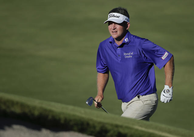 Jason Bohn runs up the slope to the 15th green during the final round of the STPC Summerlin, Sunday, Oct. 20, 2013, in Las Vegas. Bohn shot 18-under for the tournament to tie for second place with Ryo Ishikawa. (AP Photo/Julie Jacobson)