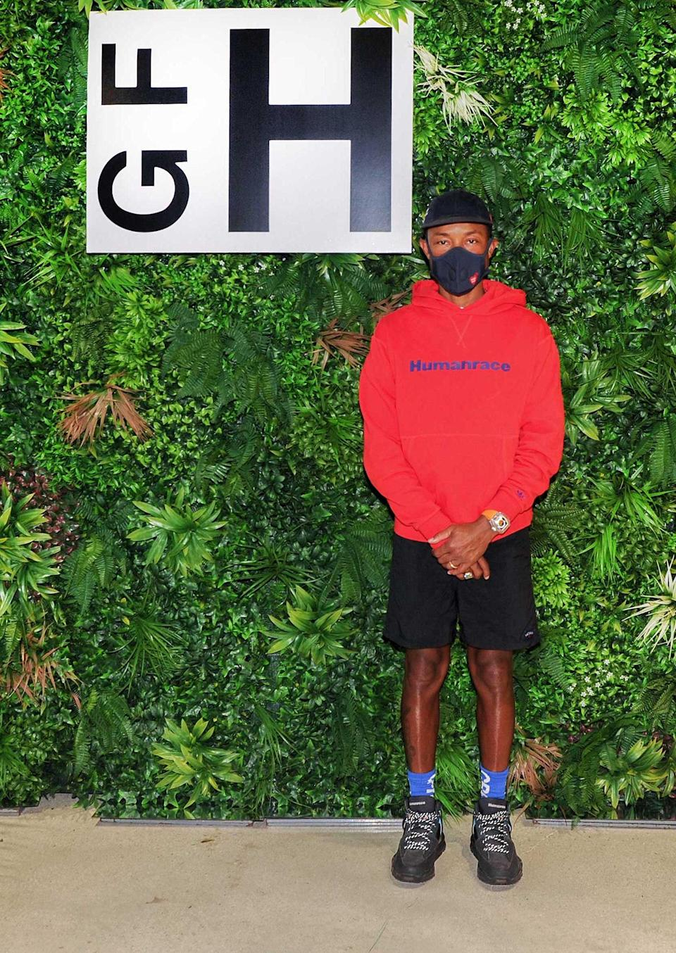 <p>Pharrell Williams attends Tina Brehon's Naturally Connected x Girl from Huntersville collection fashion show on Thursday in Miami.</p>