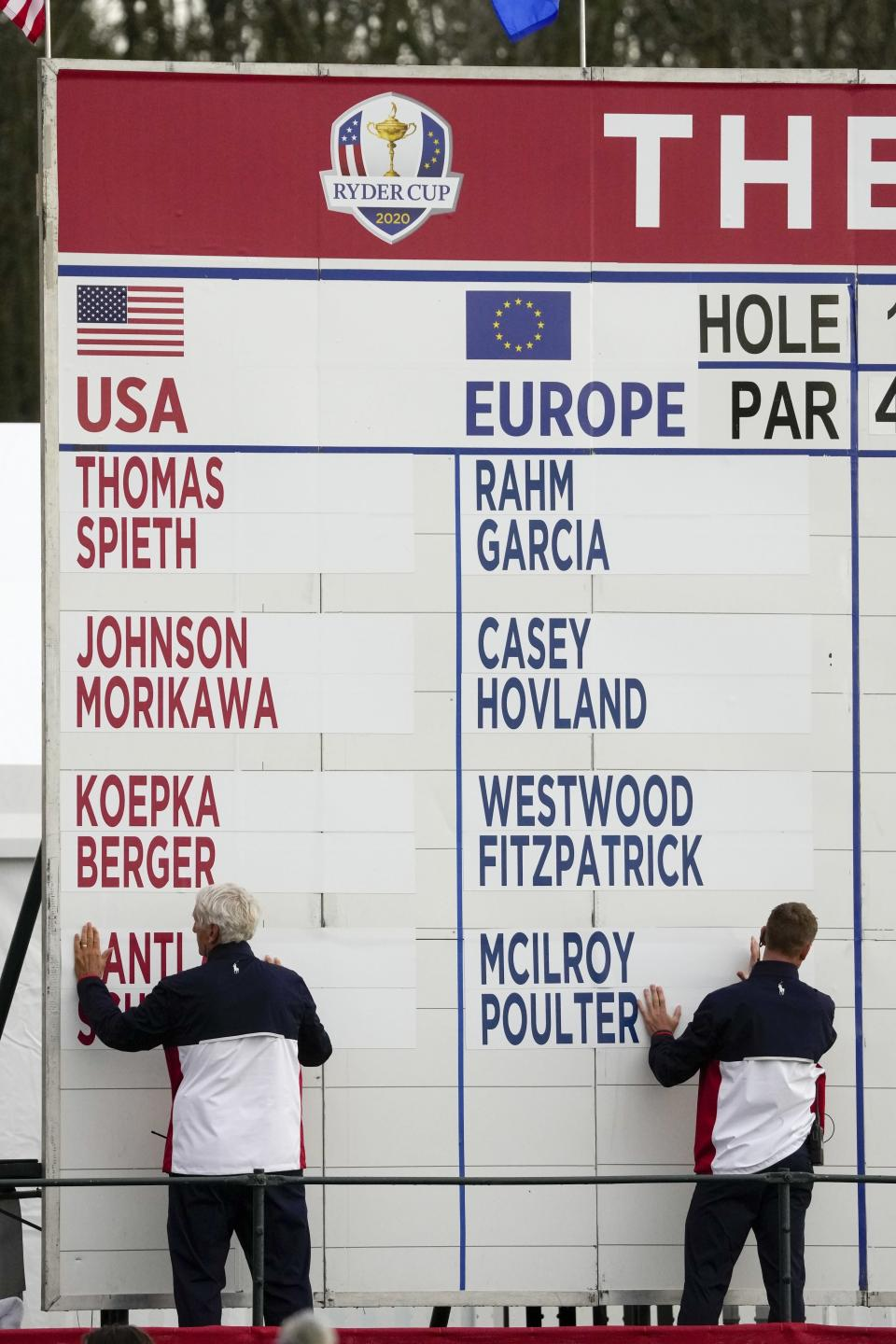 Friday's pairings are displayed during the opening ceremony for the Ryder Cup at the Whistling Straits Golf Course Thursday, Sept. 23, 2021, in Sheboygan, Wis. (AP Photo/Charlie Neibergall)