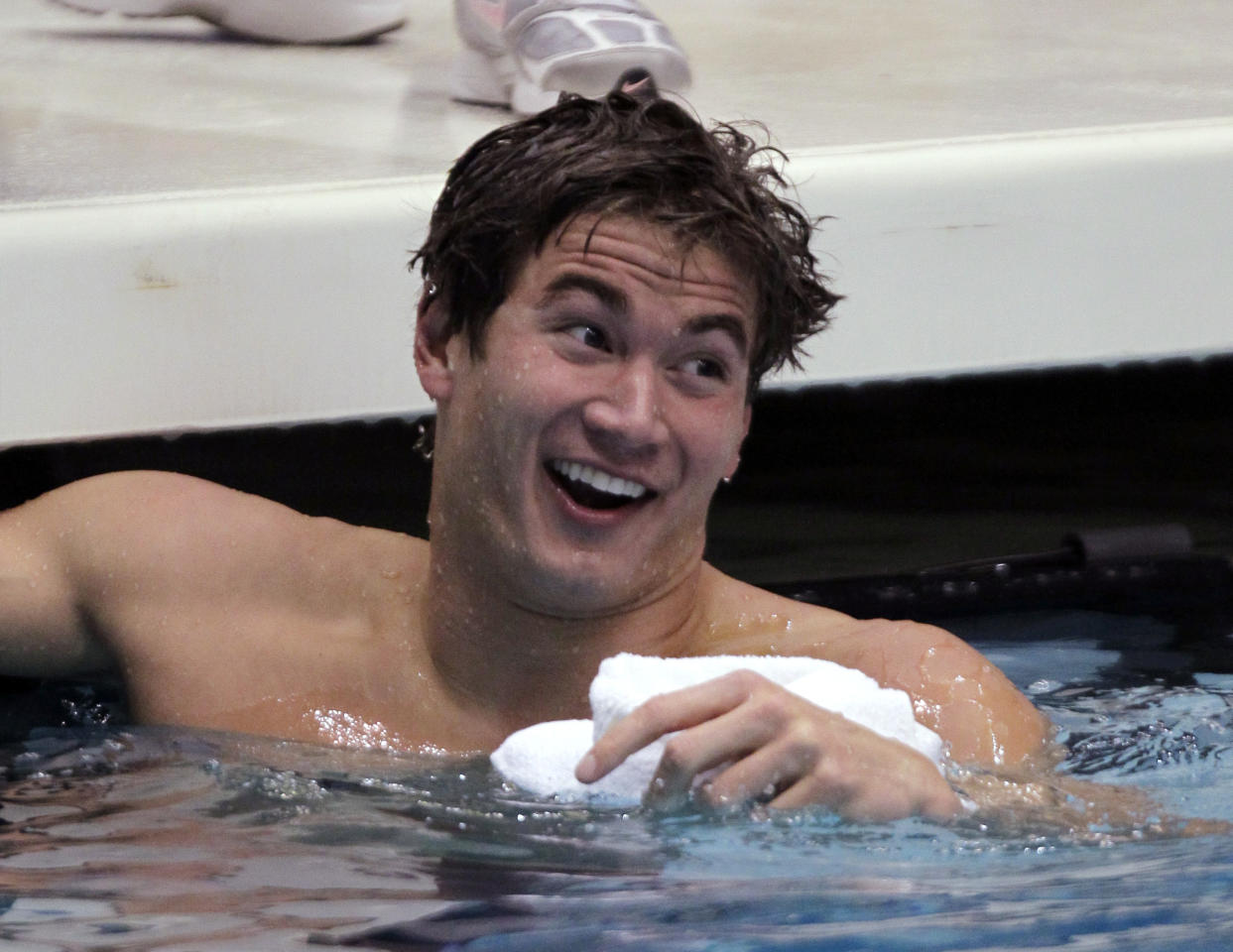 Nathan Adrian laughs as he looks at his time on the scoreboard after winning the men's 100-meter freestyle event in 48.62 seconds at the Indianapolis Grand Prix swim meet in Indianapolis, Thursday, March 29, 2012. (AP Photo/Michael Conroy)