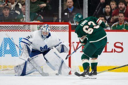 Dec 14, 2017; Saint Paul, MN, USA; Minnesota Wild forward Tyler Ennis (63) shoots in the third period against the Toronto Maple Leafs Frederik Andersen (31) at Xcel Energy Center. Mandatory Credit: Brad Rempel-USA TODAY Sports