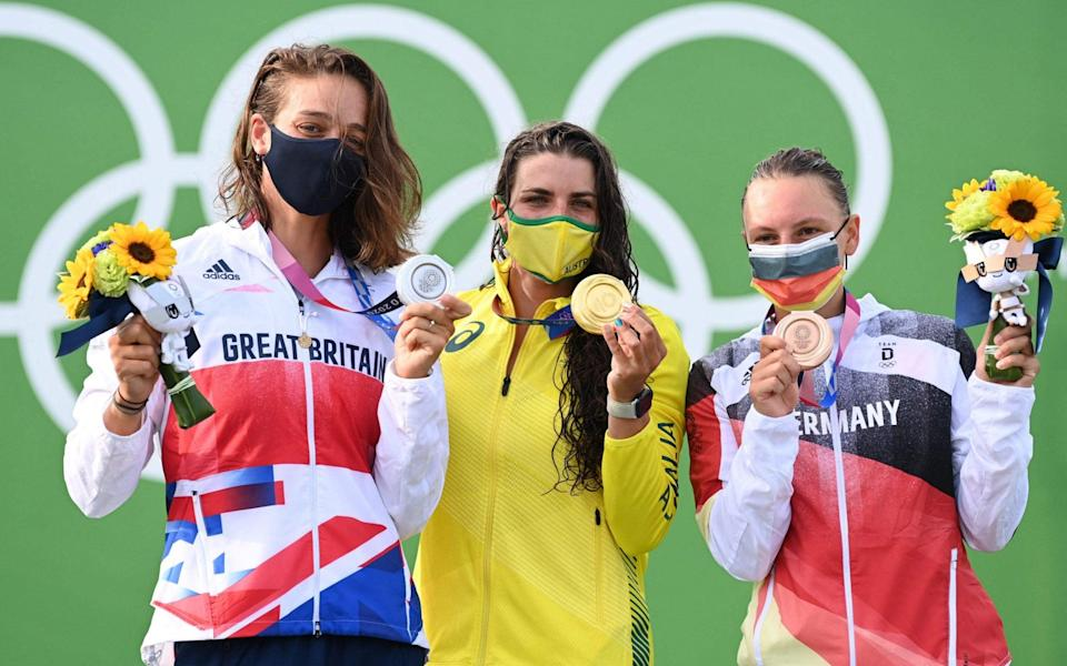 (LtoR) Britain's Mallory Franklin (silver) Australia's Jessica Fox (gold) and Germany's Andrea Herzog (bronze) pose during the medal ceremony of the women's Canoe final during the Tokyo 2020 Olympic Games at Kasai Canoe Slalom Centre in Tokyo on July 29, 2021. - CHARLY TRIBALLEAU/AFP via Getty Images