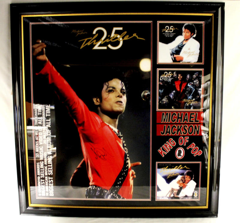 "This undated photo provided by Texas-based Gaston & Sheehan Auctioneers, Inc. shows a Michael Jackson autographed poster from the 25th anniversary of ""Thriller"" that once belonged to former Illinois Congressman Jesse Jackson Jr. It is among the items the U.S. Marshals Service started selling in an online auction Tuesday, Sept. 17, 2013, in its attempt to recoup part of the $750,000 in campaign funds the Chicago Democrat and his wife illegally spent. Both were handed prison terms last month. The auction runs through Sept. 26. (AP Photo/Courtesy Gaston & Sheehan Auctioneers, Inc.)"