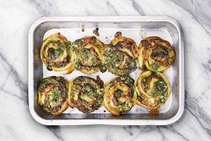 """Standing three tiers high, the magnificent Bombay sandwich is a whopper of a construction. It's also a labor of love to make at home, so this recipe embodies its spirit—a sharp, hot green chutney, cheese, and onion—in a puff-pastry roll that can be made in just minutes. <a href=""""https://www.epicurious.com/recipes/food/views/bombay-rolls-meera-sodha?mbid=synd_yahoo_rss"""" rel=""""nofollow noopener"""" target=""""_blank"""" data-ylk=""""slk:See recipe."""" class=""""link rapid-noclick-resp"""">See recipe.</a>"""