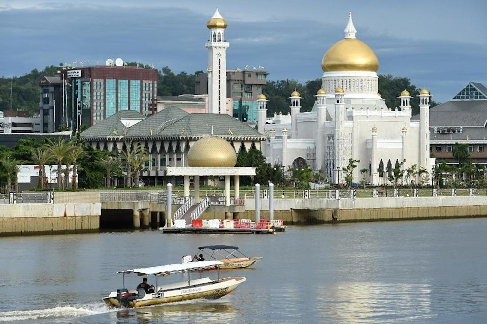 Brunei, an absolute monarchy ruled for 51 years by Sultan Hassanal Bolkiah, says it will implement the new penal code this week (AFP Photo/ROSLAN RAHMAN)