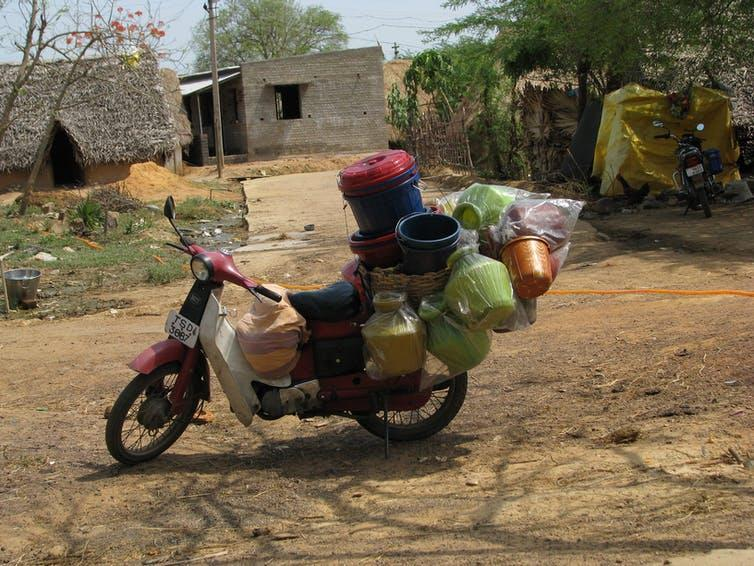 A motorbike with plastic containers and packaging attached