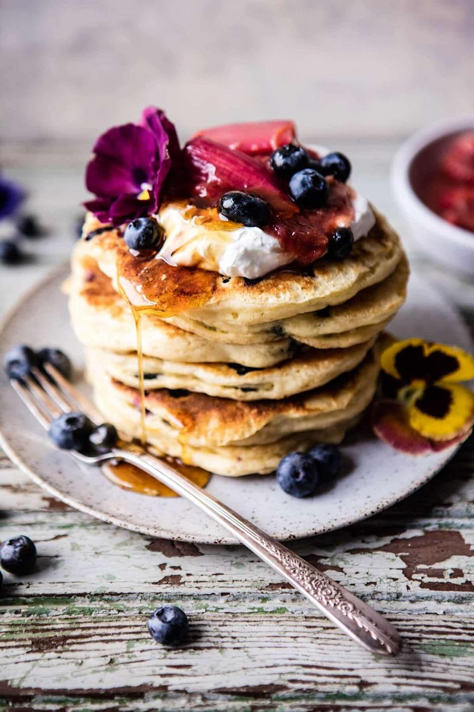 "<p>Take breakfast to a place it has never been before with this pancake recipe. The hearty almond flavor pairs effortlessly with the tart blueberry taste, so all you need to do is add syrup.</p> <p><strong>Get the recipe</strong>: <a href=""https://www.halfbakedharvest.com/blueberry-almond-pancakes/"" class=""link rapid-noclick-resp"" rel=""nofollow noopener"" target=""_blank"" data-ylk=""slk:blueberry almond pancakes"">blueberry almond pancakes</a></p>"
