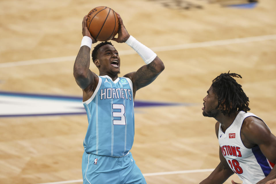 Charlotte Hornets guard Terry Rozier (3) shoots over Detroit Pistons center Isaiah Stewart in the second half of an NBA basketball game in Charlotte, N.C., Saturday, May 1, 2021. (AP Photo/Nell Redmond)