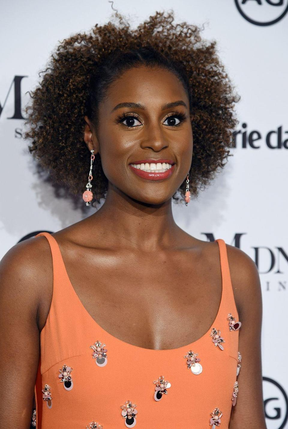 <p>The versatility of the natural hair puff makes it a go-to style on days when you want your hair out of your face but not necessarily up. This rendition from actress <strong>Issa Rae</strong> is like wearing your hair down and back at the same time. It's basically the best of of both worlds. </p>