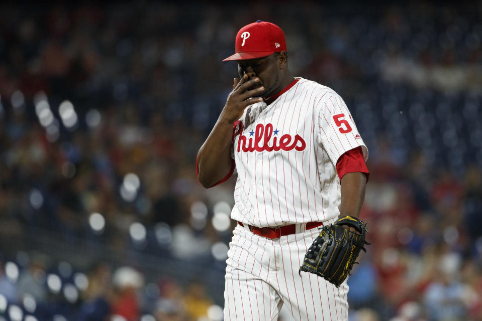 Philadelphia Phillies relief pitcher Hector Neris wipes his face as he walks off the field after the top of the ninth inning of a baseball game against the Pittsburgh Pirates, Tuesday, Aug. 27, 2019, in Philadelphia. Pittsburgh won 5-4. (AP Photo/Matt Slocum)