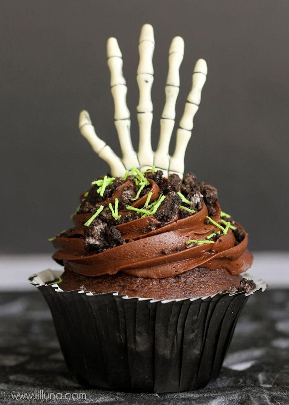 """<p>This double chocolate recipe is to die for. Don't forget to sprinkle Oreo cookie """"dirt"""" on top!</p><p><strong>Get the recipe at <a href=""""http://eighteen25.com/2015/09/creepy-halloween-cupcakes/"""" rel=""""nofollow noopener"""" target=""""_blank"""" data-ylk=""""slk:Eighteen 25"""" class=""""link rapid-noclick-resp"""">Eighteen 25</a>.</strong></p><p><a class=""""link rapid-noclick-resp"""" href=""""https://www.amazon.com/Hamilton-Beach-62682RZ-Mixer-Snap/dp/B001CH0ZLE?tag=syn-yahoo-20&ascsubtag=%5Bartid%7C10050.g.1366%5Bsrc%7Cyahoo-us"""" rel=""""nofollow noopener"""" target=""""_blank"""" data-ylk=""""slk:SHOP HAND MIXERS"""">SHOP HAND MIXERS</a></p>"""