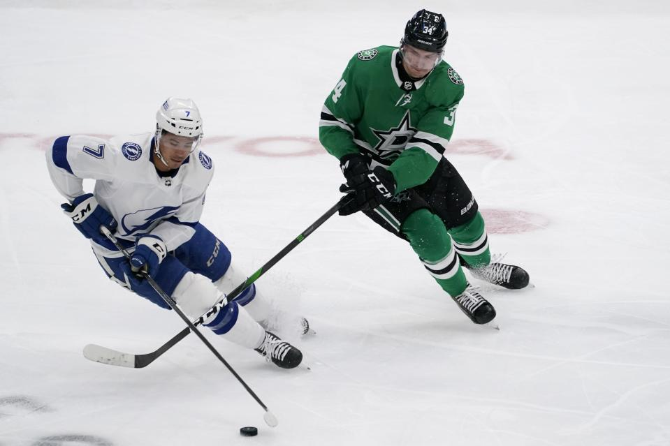 Tampa Bay Lightning right wing Mathieu Joseph (7) intercepts a pass intended for Dallas Stars' Denis Gurianov (34) in the second period of an NHL hockey game in Dallas, Tuesday, March 2, 2021. (AP Photo/Tony Gutierrez)