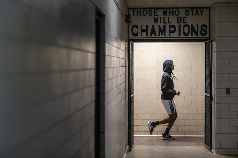 Flint High's Dion Brown warms up before a game against Beecher.
