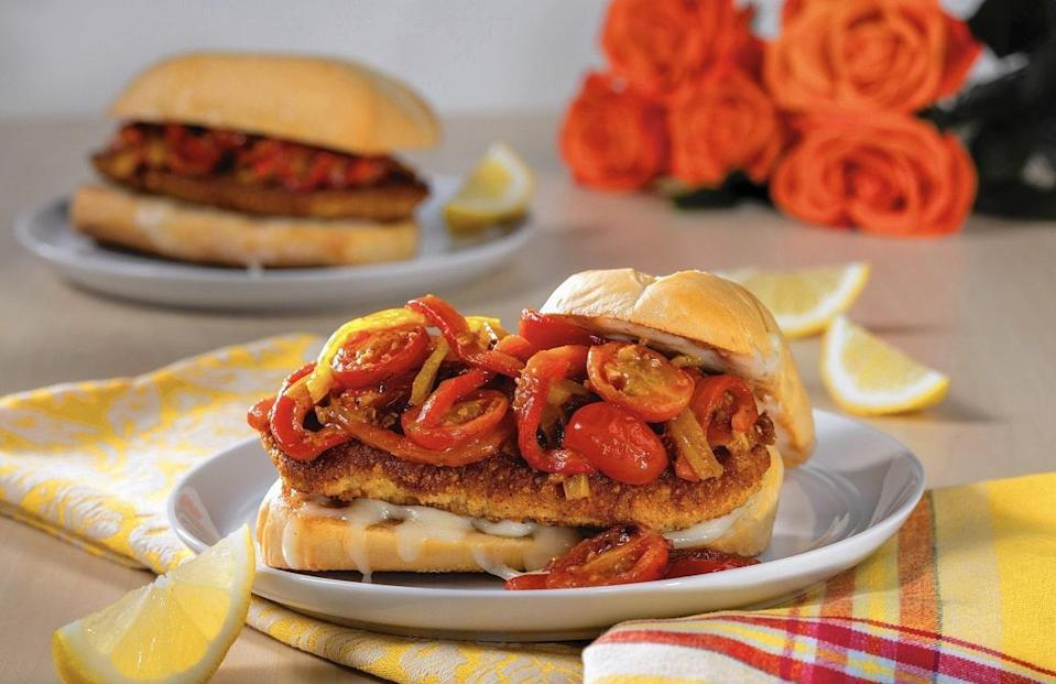 """<p>A classic Italian entree collides with lunch to make this chicken Parmesan sandwich. But be warned, this recipe doesn't cut any corners when it comes to flavor. The chicken needs about two hours to soak in buttermilk before getting dredged in its breadcrumb and Parmesan cheese mix.</p> <p><a href=""""https://www.thedailymeal.com/best-recipes/chicken-parmesan-sandwich?referrer=yahoo&category=beauty_food&include_utm=1&utm_medium=referral&utm_source=yahoo&utm_campaign=feed"""" rel=""""nofollow noopener"""" target=""""_blank"""" data-ylk=""""slk:For the Chicken Parmesan Sandwich recipe, click here."""" class=""""link rapid-noclick-resp"""">For the Chicken Parmesan Sandwich recipe, click here.</a></p>"""