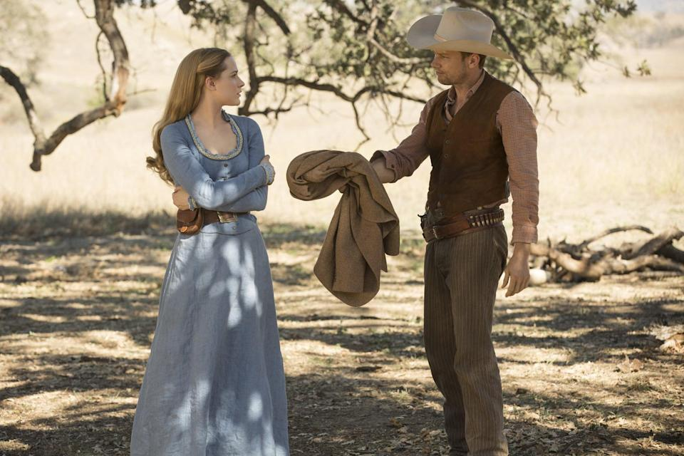 <p><strong>For Dolores:</strong> A long-sleeved blue Western dress with a brown leather belt.</p> <p><strong>For William:</strong> Brown pants and shirt with a leather vest on top. Top it off with a big cowboy hat.</p>