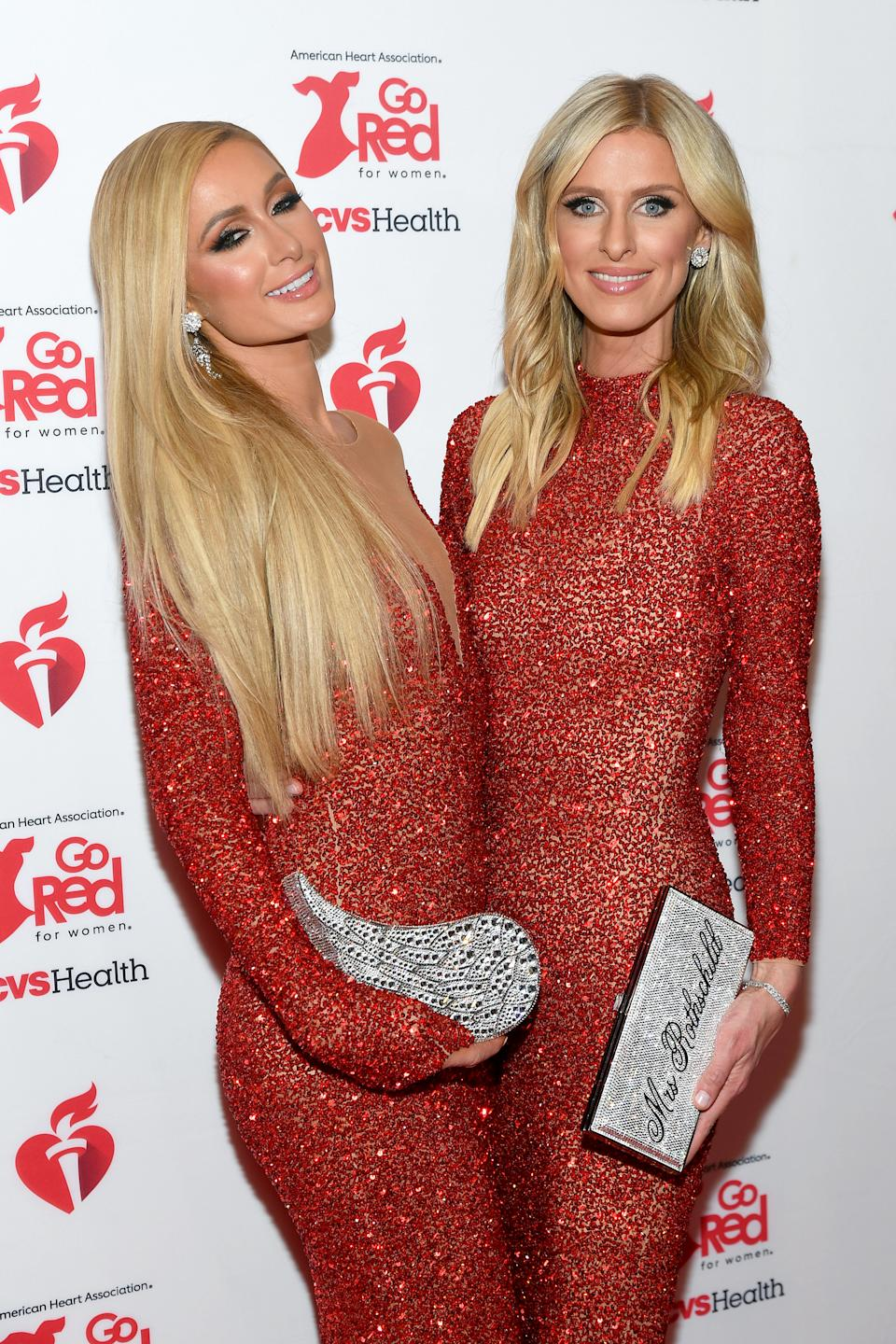 NEW YORK, NEW YORK - FEBRUARY 05: Paris Hilton and Nicky Hilton Rothschild attend The American Heart Association's Go Red for Women Red Dress Collection 2020 at Hammerstein Ballroom on February 05, 2020 in New York City. (Photo by Mike Coppola/Getty Images for American Heart Association )
