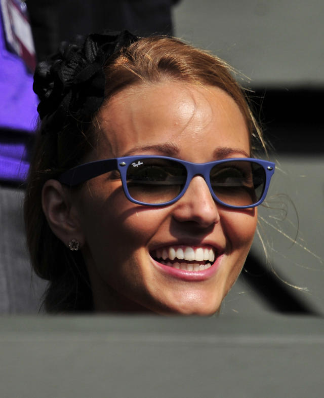 Jelena Ristic, partner of Serbian player Novak Djokovic, watches him play against French player Jeremy Chardy during a Men's Singles match at the 2011 Wimbledon Tennis Championships at the All England Tennis Club, in south-west London, on June 21, 2011. AFP PHOTO/GLYN KIRK/RESTRICTED TO EDITORIAL USE (Photo credit should read GLYN KIRK/AFP/Getty Images)