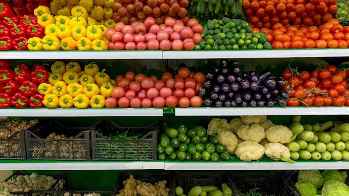 Fresh organic Vegetables and fruits on shelf in supermarket, farmers market.