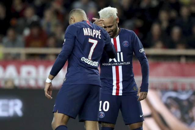 PSG's Neymar, right, celebrates with PSG's Kylian Mbappe after scoring his side's second goal during the French League One soccer match between Monaco and Paris Saint-Germain at the Louis II stadium in Monaco, Wednesday, Jan. 15, 2019. (AP Photo/Daniel Cole)