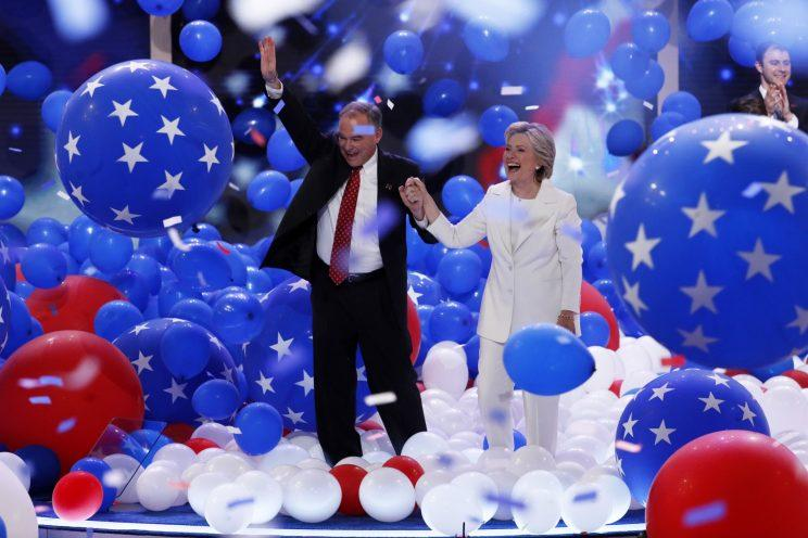 Tim Kaine and Hillary Clinton celebrate on the final day of the Democratic National Convention in Philadelphia, July 28, 2016. (Photo: J. Scott Applewhite/AP)