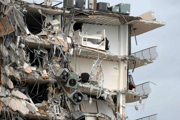 PHOTO: Items and debris dangle from a section of the oceanfront Champlain Towers South Condo that partially collapsed, June 24, 2021, in the Surfside area of Miami, Fla. (South Florida Sun-Sentinel via AP)